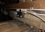 "Back of the table, the X axis - notice the ""stop"" bolt to the left of the readhead bracket - Click for a larger picture!"